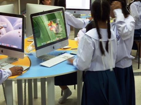 Free Stock Photo of School students using Apple Macs
