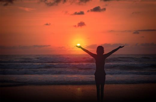 Free Stock Photo of Celebrating life - A woman raises her arms at sunset