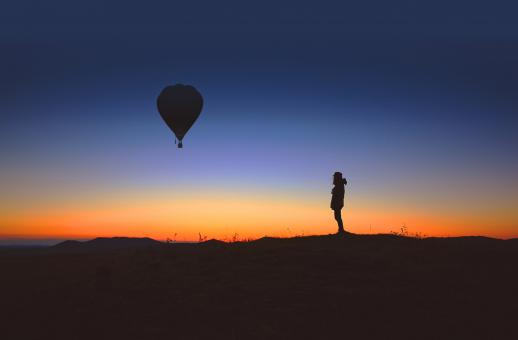Free Stock Photo of Alone person observes an hot air balloon at sunrise