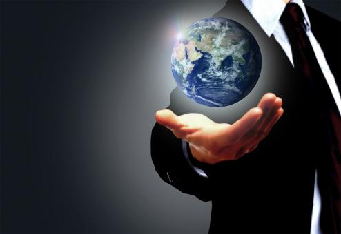 Free Stock Photo of Hand of a businessman holding Earth globe - Globalization concept