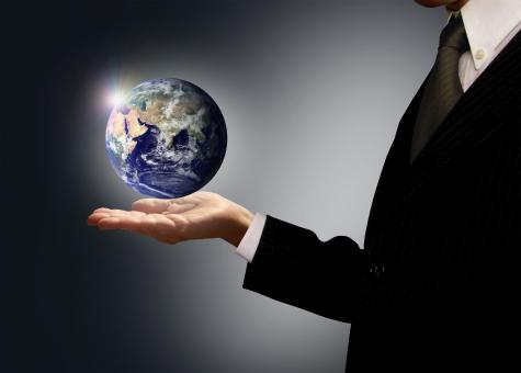 Free Stock Photo of Businessman holding Earth globe - Globalization concept