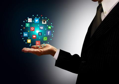 Free Stock Photo of Businessman holding hologram with social media network icons