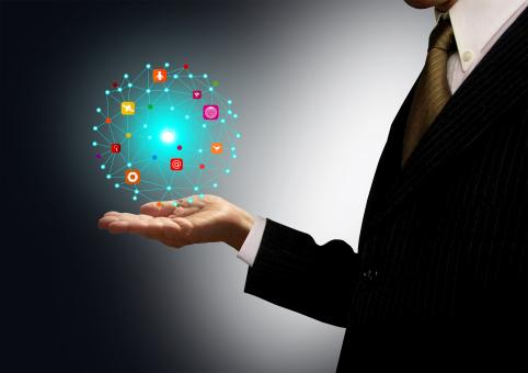 Free Stock Photo of Businessman holding a ball with information technology icons
