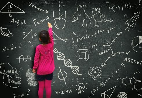 Free Stock Photo of Little girl writing on blackboard