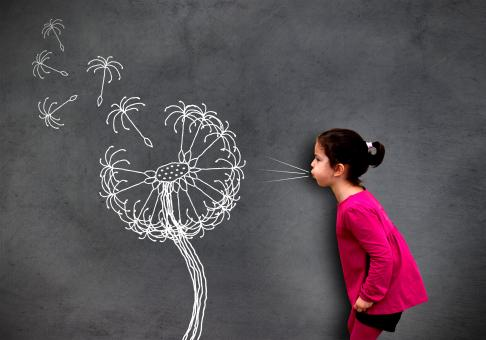 Free Stock Photo of Little cute girl blowing dandelion seeds on chalkboard