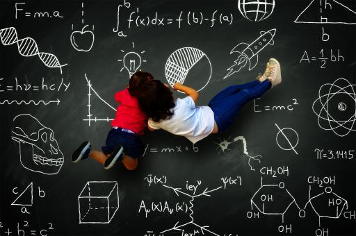 Free Stock Photo of Two little girls writing on a blackboard with science subjects