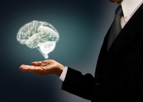 Free Stock Photo of Businessman holding a virtual brain in the palm - Skills concept
