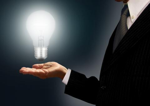 Free Stock Photo of Businessman holding a lightbulb - Ideas and creativity concept