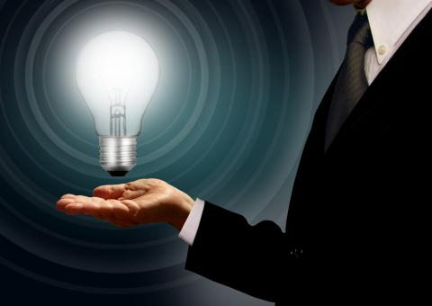 Free Stock Photo of Businessman holding a lightbulb