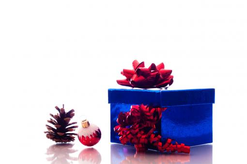 Free Stock Photo of Christmas ornaments and gift box on white