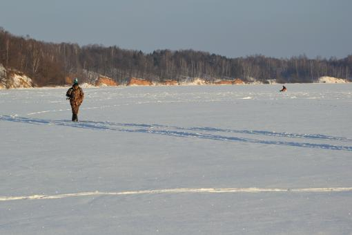 Free Stock Photo of Angler on the frozen lake