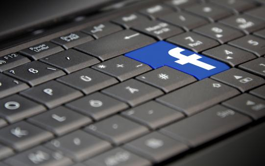 Free Stock Photo of Facebook Logo on Laptop Keyboard