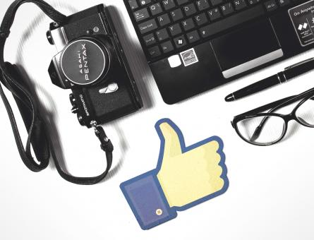 Free Stock Photo of Facebook Thumbs-Up with Laptop and Camera