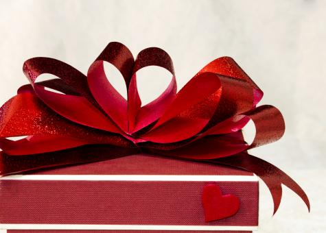 Free Stock Photo of Red ribbon bow close up