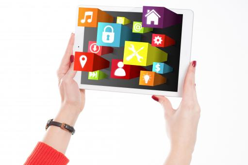Free Stock Photo of Woman Holding Tablet with App Icons