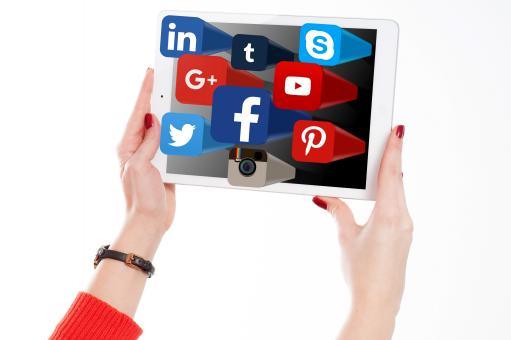 Free Stock Photo of Woman Holding Tablet with Social Media Networks Logos