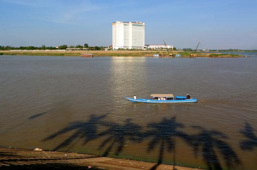 Free Stock Photo of Tonle Sap River, boat and Sokka Hotel