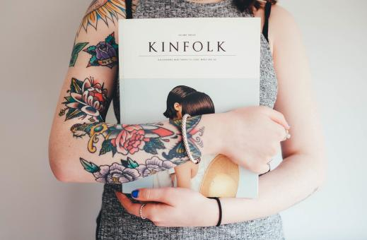 Free Stock Photo of Tattooed girl holding a book