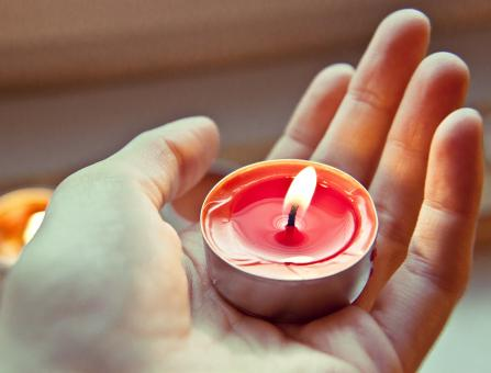 Free Stock Photo of Holding a Candle