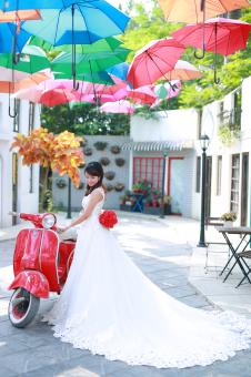 Free Stock Photo of Bride posing with red scooter