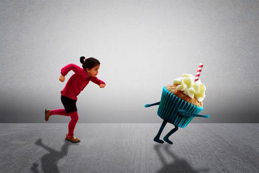 Free Stock Photo of Child Chasing Cupcake - Healthy Diet versus Child Obesity