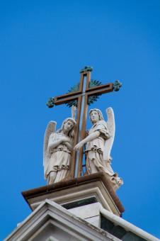 Free Stock Photo of Statues on top of Church