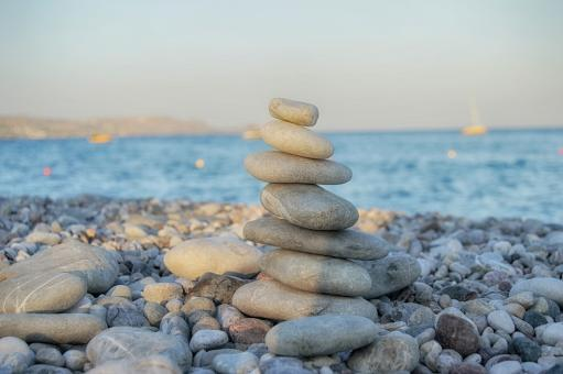 Free Stock Photo of Zen-like pyramid of stone on the beach
