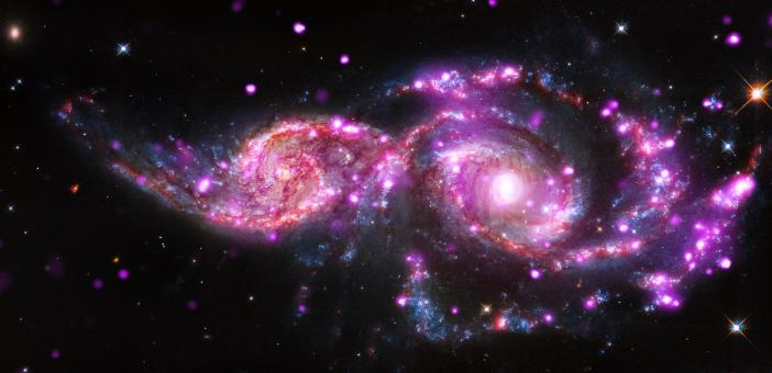 Free Stock Photo of Colliding Spiral Galaxies