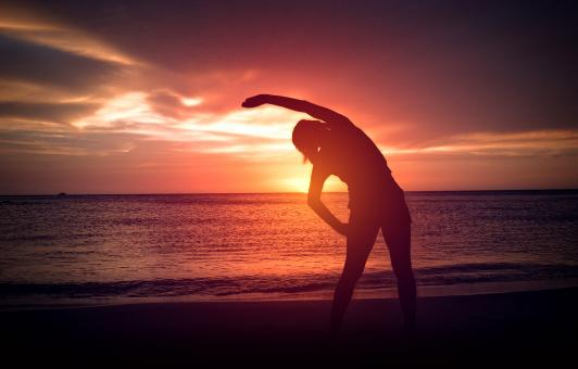 Free Stock Photo of Warm-Up exercise on the Beach at Sunset