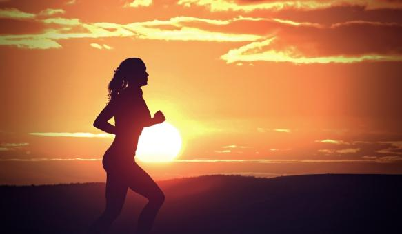 Free Stock Photo of Young Woman Jogging at Sunset