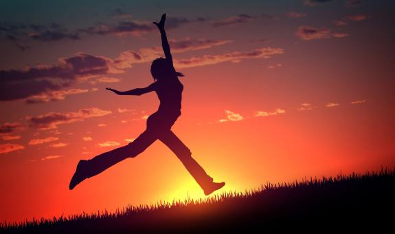 Free Stock Photo of Young Woman Jumps at Sunset