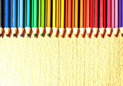 Free Stock Photo of Color Pencils in a Row with Copyspace