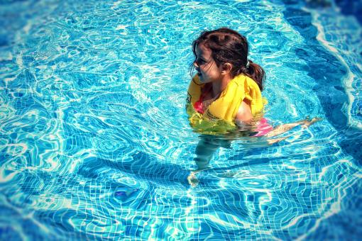 Free Stock Photo of Little Girl Learning To Swim