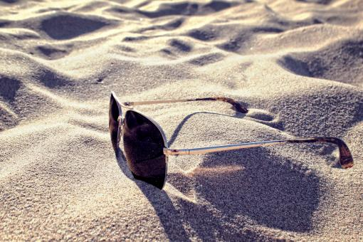 Free Stock Photo of Sunglasses on the Sand - Summer Concept