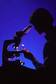 Free Stock Photo of Scientist with Microscope