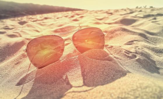 Free Stock Photo of Sunglasses on the Sand at Sunset