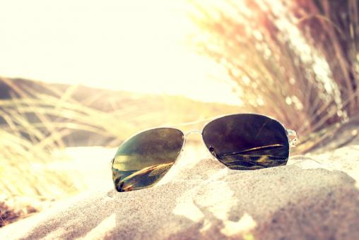 Free Stock Photo of Sunglasses on the Sand Dunes