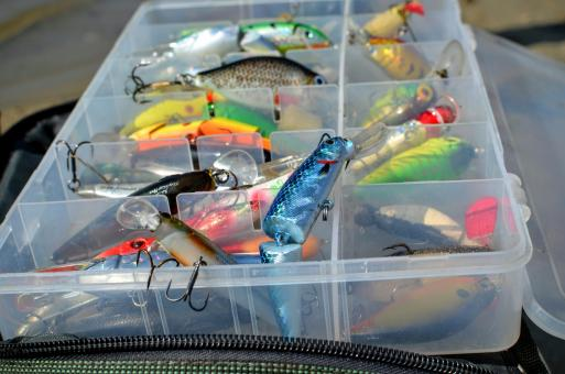 Free Stock Photo of Box with lures lies on the fishing bag