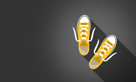 Free Stock Photo of Yellow Sneakers on Dark Background - With Copyspace