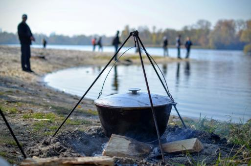 Free Stock Photo of Cooking food in nature against the backdrop of the river