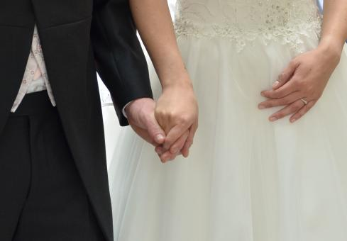 Free Stock Photo of Married Couple Holding Hands
