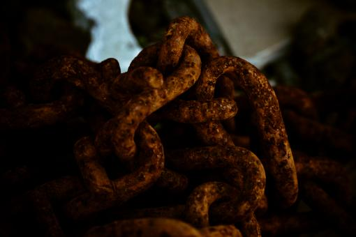 Free Stock Photo of Twisted Rusty Chain