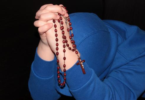Free Stock Photo of Holding String of Beads - Praying
