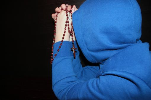 Free Stock Photo of Man in Blue Praying