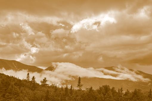 Free Stock Photo of Glowing White Mountain Clouds - Sepia Cream Dream