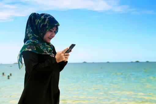 Free Stock Photo of Hijab on the beach