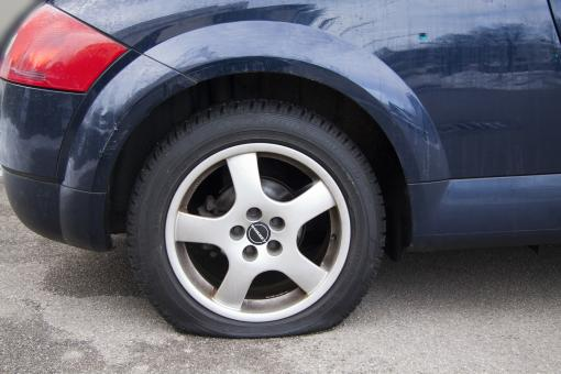 Free Stock Photo of Flat Tire