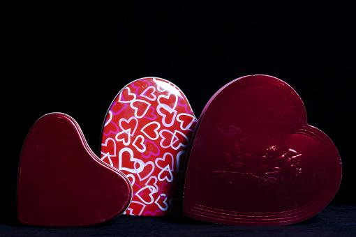 Free Stock Photo of Heart Shaped Gift Boxes on Black
