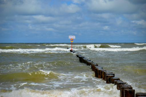 Free Stock Photo of Breakwaters with a wooden deck in a stormy sea