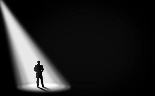 Free Stock Photo of  Businessman Alone in the Dark - Under the Spotlight - With Copyspace
